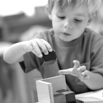 Boy stacking blocks