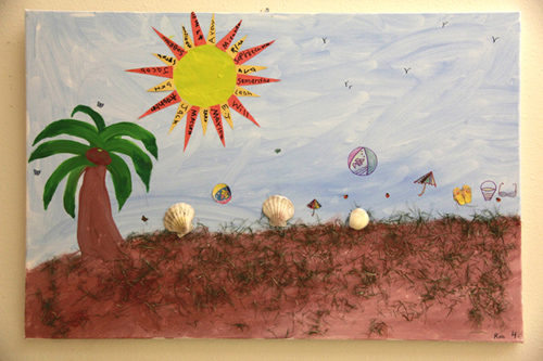 Child's artwork depicting a tropical beach