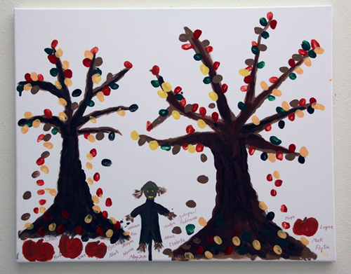 Child's painting of autumn trees, a scarecrow, and pumpkins