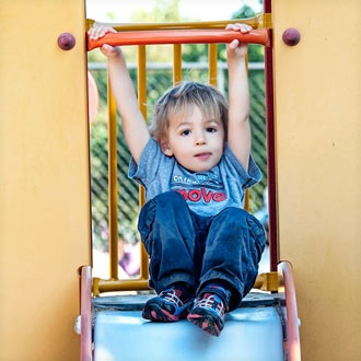 Toddler playing on slide